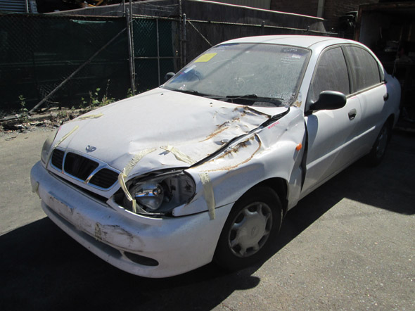 Wrecking Daewoo Lanos Sedan 1.5i -A- White. Sydney Wreckers.